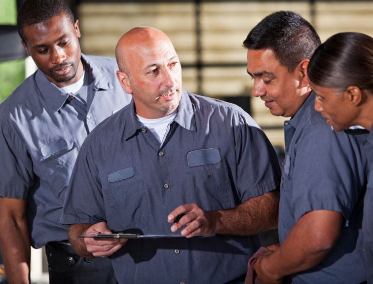 Pictured are 4 quality Napier truck driver training instructors discussing course material.