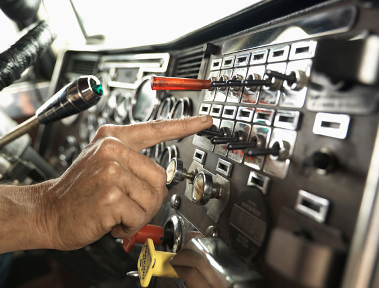 Pictured is a diver flipping a switch on the control panel.